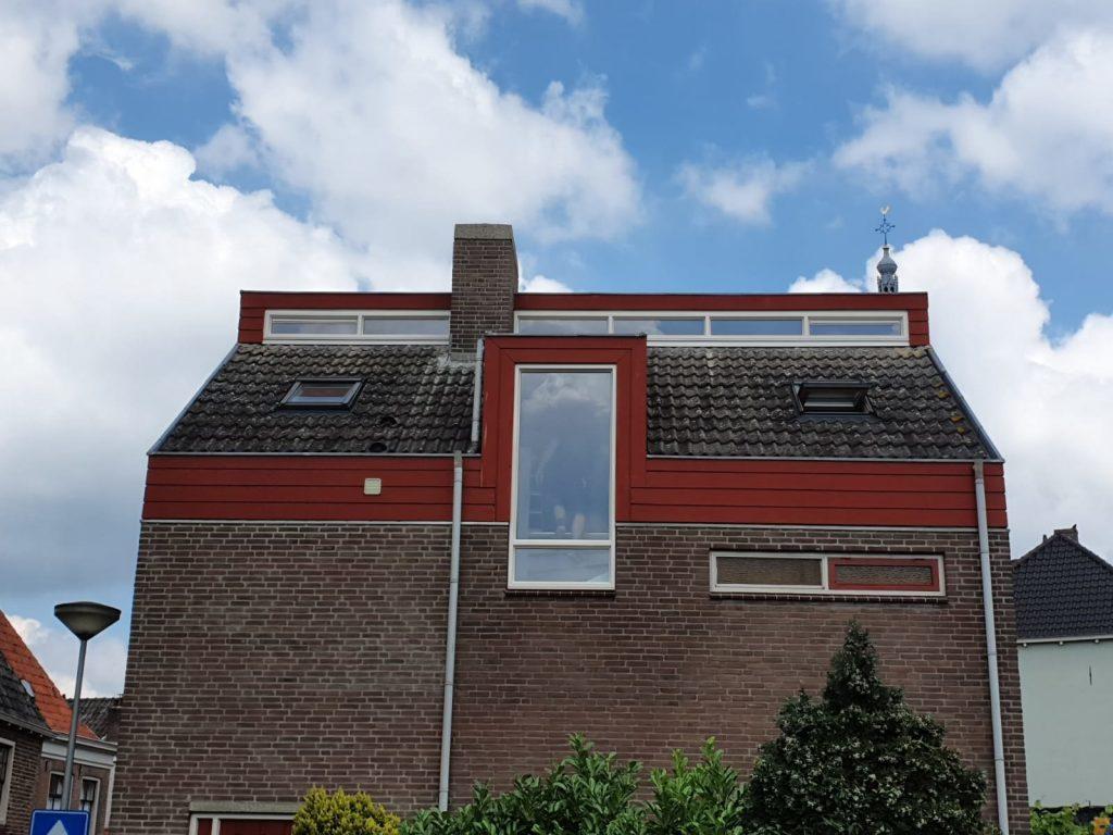 doesburg bovenin dak en groot kozijn 1e verdieping